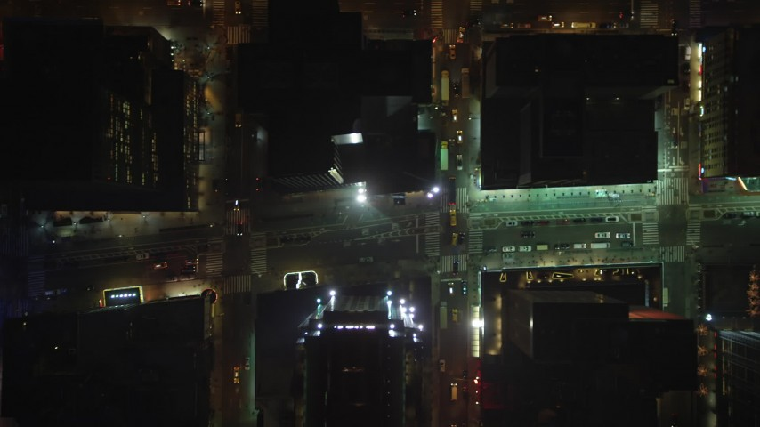 Bird's eye view of Broadway and 7th Avenue in Midtown Manhattan, New York City, winter, night Aerial Stock Footage AX65_0353