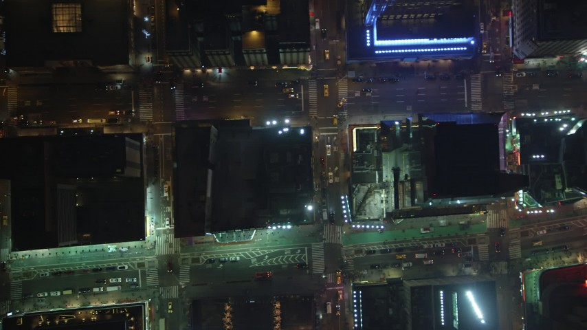 Bird's eye view of Broadway and 7th Avenue, revealing Times Square in Midtown Manhattan, New York City, winter, night Aerial Stock Footage | AX65_0354