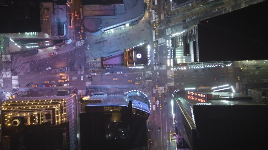 Bird's eye of Broadway, 7th Avenue and cross streets in Times Square, Midtown Manhattan, New York City, winter, night Aerial Stock Footage | AX65_0358