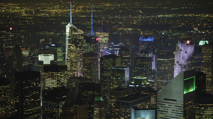5K stock footage aerial video flyby skyscrapers in Midtown Manhattan, New York City, winter, night Aerial Stock Footage | AX65_0360