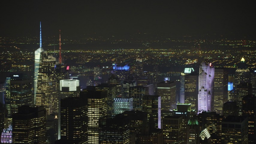 5K stock footage aerial video flyby Midtown Manhattan's numerous skyscrapers, New York City, winter, night Aerial Stock Footage | AX65_0361