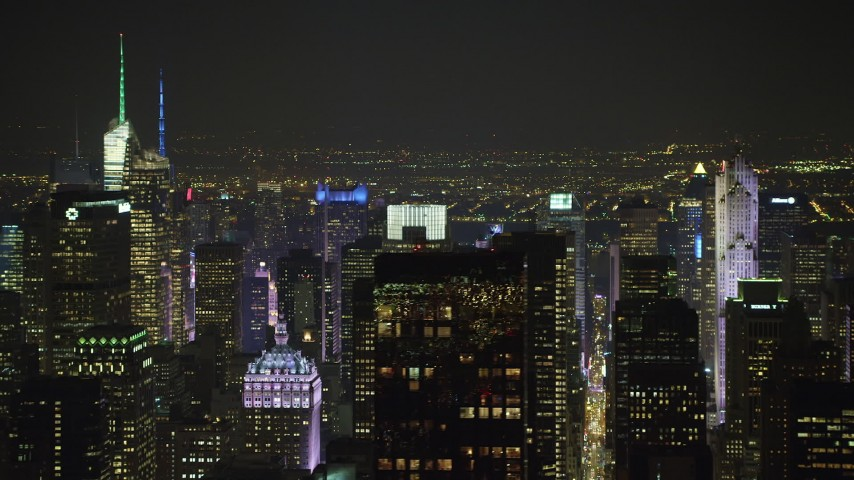 5K stock footage aerial video flyby Midtown Manhattan's numerous skyscrapers to reveal the Chrysler Building, New York City, winter, night Aerial Stock Footage | AX65_0362