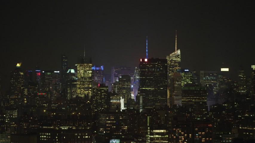 5K stock footage aerial video of the skyline of Midtown Manhattan, New York City, winter, night Aerial Stock Footage | AX65_0371