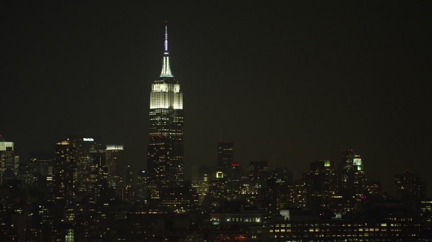 The Empire State Building skyscraper in Midtown Manhattan, New York City, winter, night Aerial Stock Footage | AX65_0372
