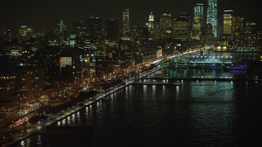5K stock footage aerial video approach West Street and piers in Greenwich Village, skyscrapers in Lower Manhattan, New York City, winter, night Aerial Stock Footage | AX65_0373