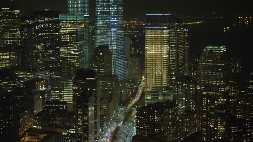 5K stock footage aerial video approach base of Freedom Tower and tilt toward West Street in Lower Manhattan, New York City, winter, night Aerial Stock Footage | AX65_0378