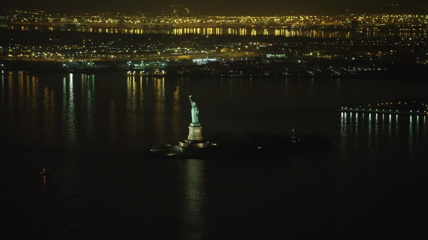 Statue of Liberty monument on Liberty Island in New York, winter, night Aerial Stock Footage | AX65_0388