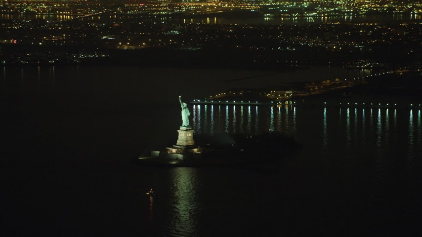 5K stock footage aerial video of Statue of Liberty monument, Liberty Island in New York, winter, night Aerial Stock Footage | AX65_0390