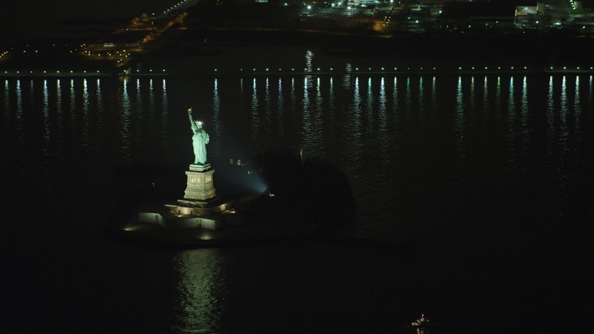 Approaching the Statue of Liberty in New York, winter, night Aerial Stock Footage | AX65_0392