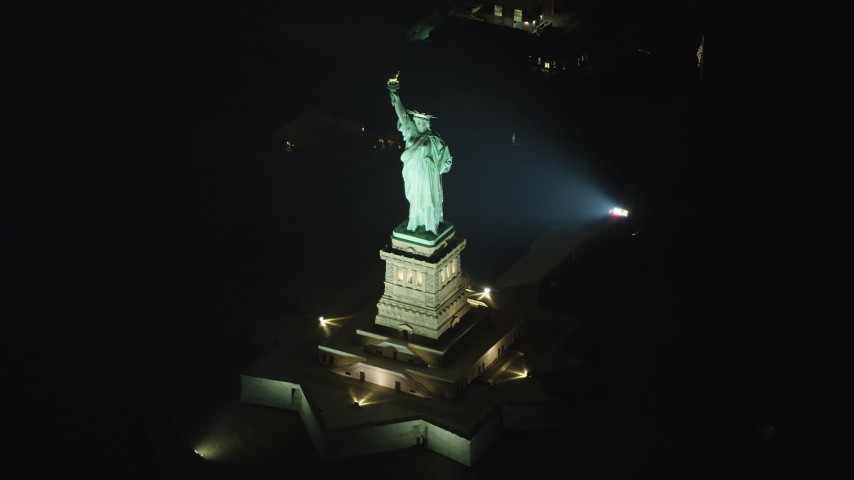 Slowly approaching the Statue of Liberty in New York, winter, night Aerial Stock Footage | AX65_0394