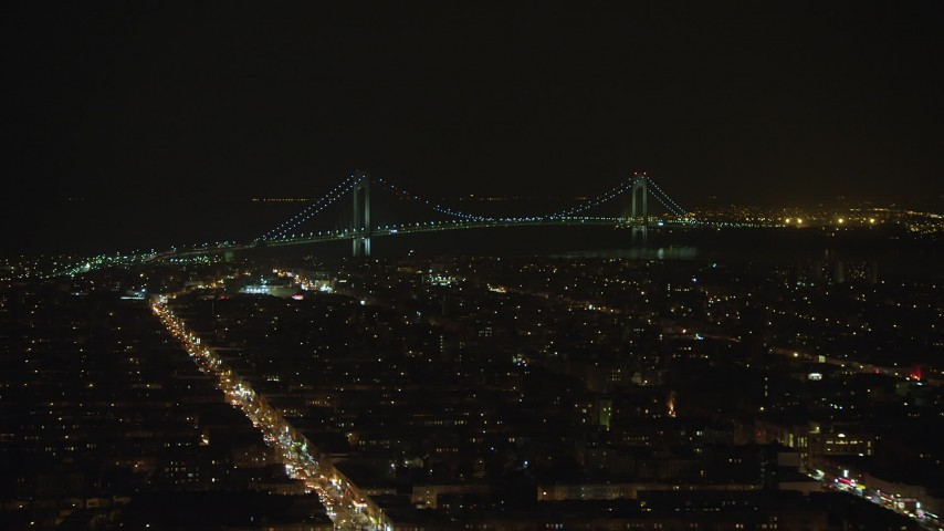 5K stock footage aerial video of Verrazano-Narrows Bridge seen from Brooklyn neighborhoods in New York City, winter, night Aerial Stock Footage | AX65_0396
