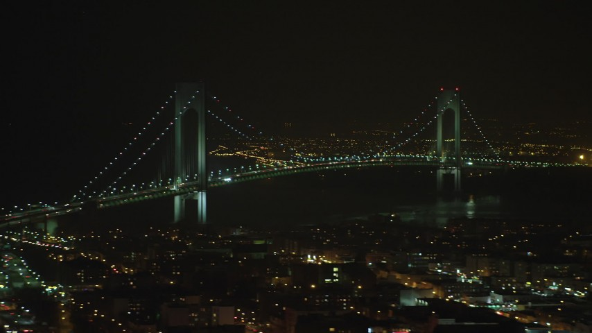 Flyby the Verrazano-Narrows Bridge in New York City, winter, night Aerial Stock Footage | AX65_0398