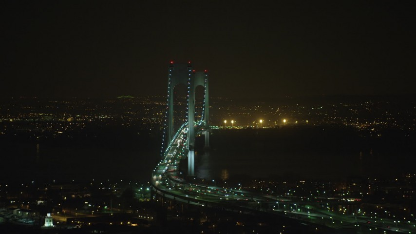 Light traffic on the Verrazano-Narrows Bridge in New York City, winter, night Aerial Stock Footage | AX65_0400