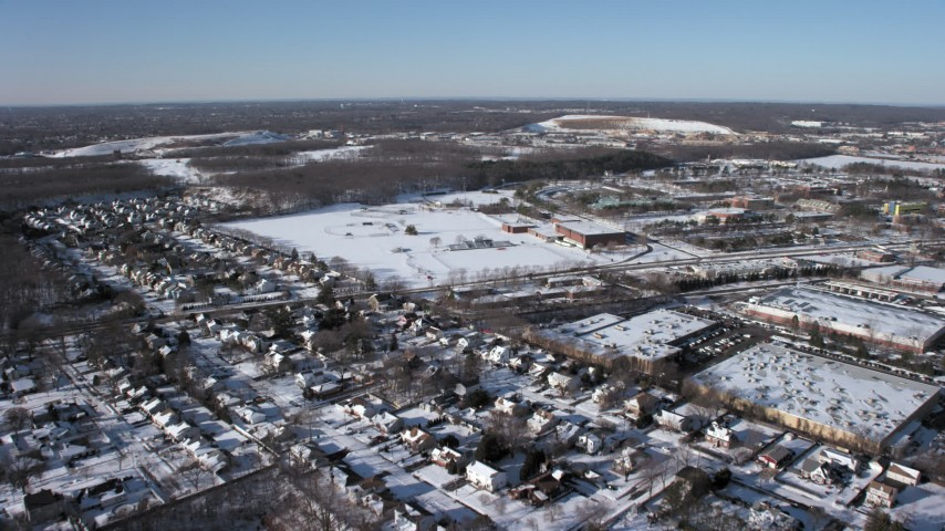 5K stock footage aerial video of State University of New York at Farmingdale, Long Island in snow Aerial Stock Footage | AX66_0002