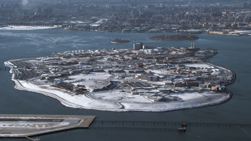 Penitentiary on Rikers Island in snow New York  Aerial Stock Footage | AX66_0046