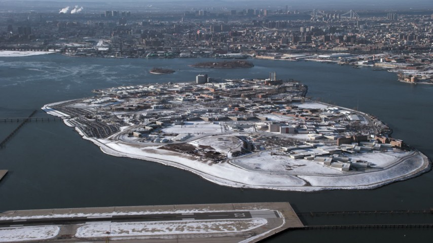 Penitentiary on Rikers Island in snow New York Aerial Stock Footage | AX66_0047