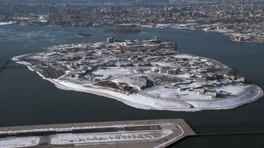 5K aerial stock footage video of the prison on Rikers Island in snow New York Aerial Stock Footage | AX66_0047