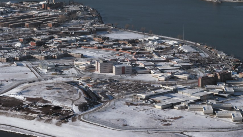 Prison buildings on Rikers Island in snow New York Aerial Stock Footage | AX66_0048