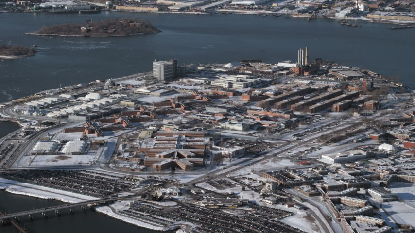 Prison buildings on Rikers Island in snow  New York Aerial Stock Footage | AX66_0049