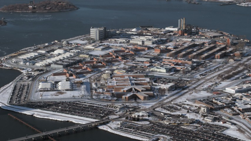 Prison buildings Rikers Island Prison in snow, New York Aerial Stock Footage | AX66_0050