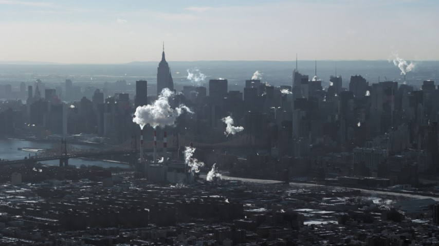 5K stock footage aerial video of smoke stacks and skyscrapers in Midtown Manhattan, New York Aerial Stock Footage | AX66_0051