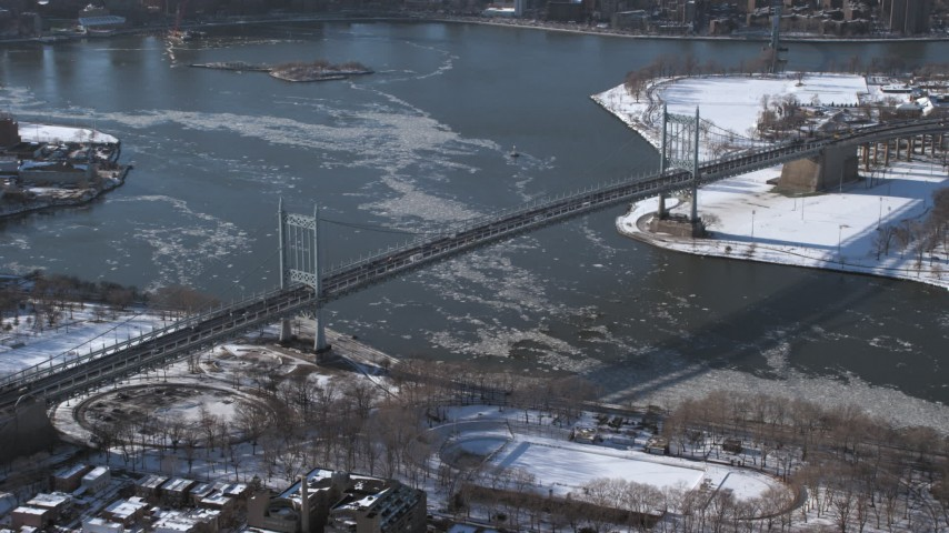 5K stock footage aerial video of Robert F Kennedy Bridge and icy Harlem River, New York Aerial Stock Footage | AX66_0053