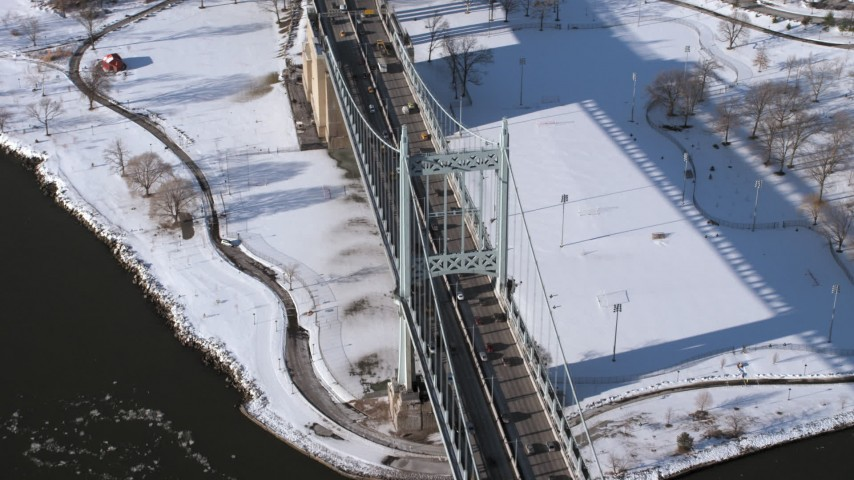 5K stock footage aerial video orbit the Robert F Kennedy Bridge in winter, New York Aerial Stock Footage | AX66_0055
