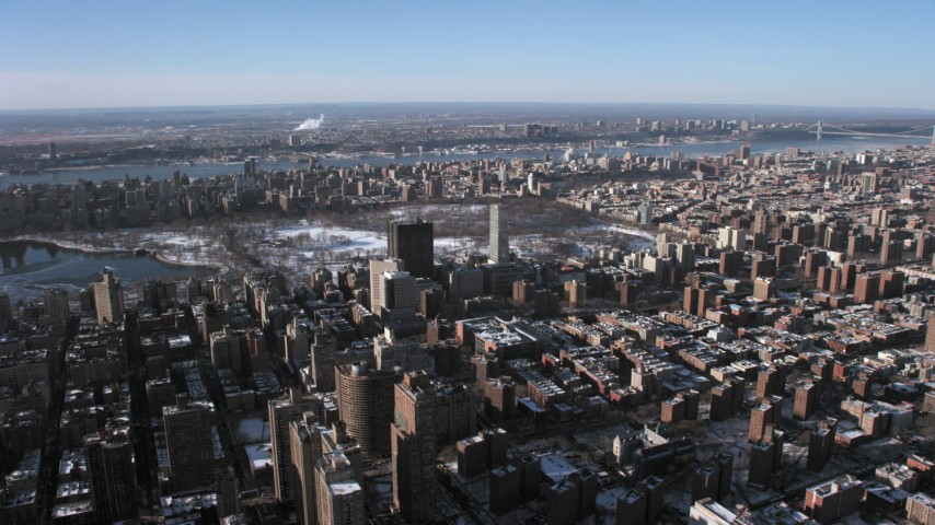 5K stock footage aerial video of hospital buildings and city sprawl on Upper East Side, New York City Aerial Stock Footage | AX66_0057