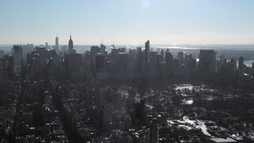 5K stock footage aerial video of Midtown Manhattan's towering skyscrapers during winter, New York City Aerial Stock Footage | AX66_0058