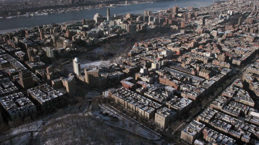 5K stock footage aerial video tilt from Central Park to reveal Columbia University with snow, New York City Aerial Stock Footage | AX66_0059