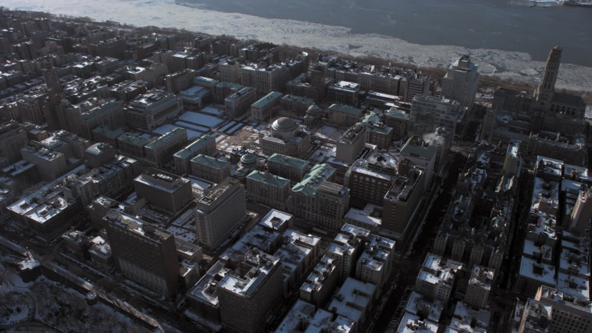 5K stock footage aerial video orbit the Columbia University campus with snow, New York City Aerial Stock Footage | AX66_0062