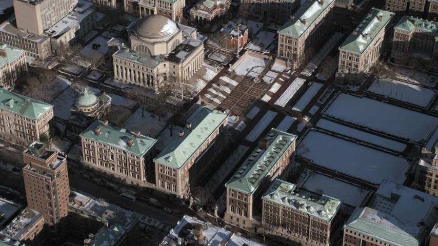 5K stock footage aerial video orbit the Columbia University campus and library with snow, New York City Aerial Stock Footage | AX66_0066