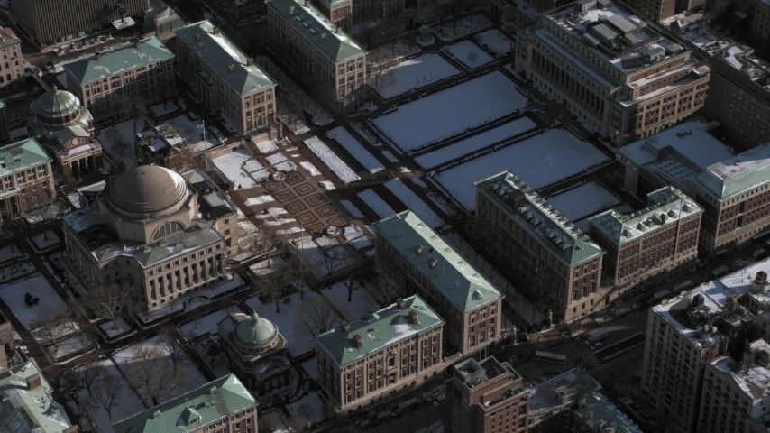 5K stock footage aerial video of library on Columbia University campus with snow, New York City Aerial Stock Footage | AX66_0067