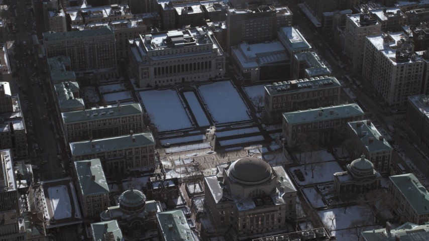 5K stock footage aerial video of circling the library and snow covered grounds at Columbia University,  New York City Aerial Stock Footage | AX66_0069
