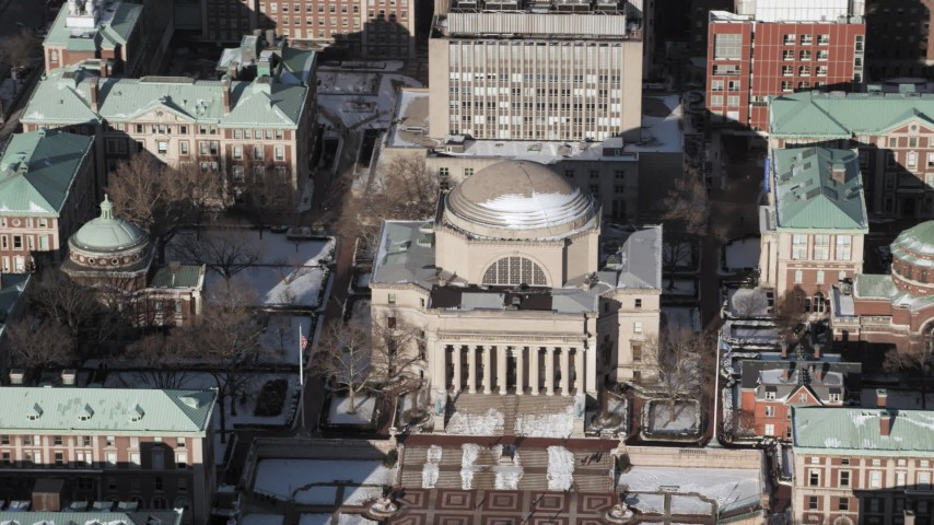 Columbia University Low Memorial Library with snow, New York City Aerial Stock Footage | AX66_0072