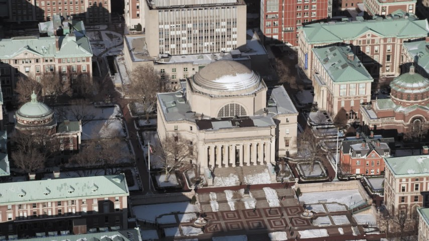 5K aerial video orbit Columbia University's Low Memorial Library with snow, New York City Aerial Stock Footage | AX66_0072