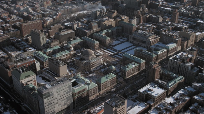 5K stock footage aerial video of a view of the Columbia University campus with snow, Morningside Heights, New York City Aerial Stock Footage | AX66_0075