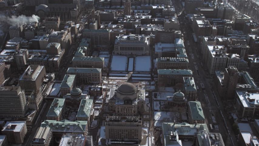 5K stock footage aerial video orbit around the Columbia University campus with snow, New York City Aerial Stock Footage | AX66_0076