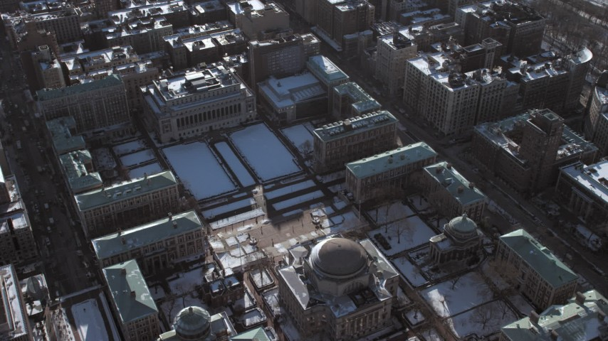 5K stock footage aerial video of Columbia University campus buildings with snow, New York City Aerial Stock Footage | AX66_0077
