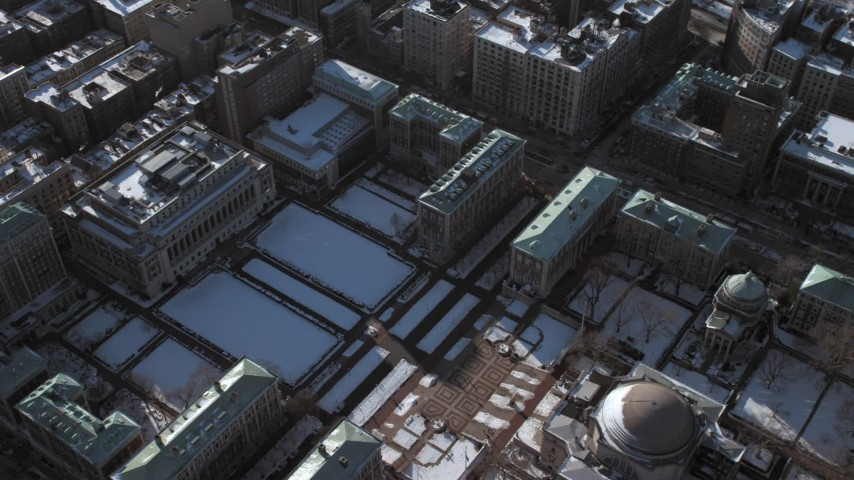 5K stock footage aerial video of Columbia University Graduate School of Journalism and ground with snow, New York City Aerial Stock Footage | AX66_0078