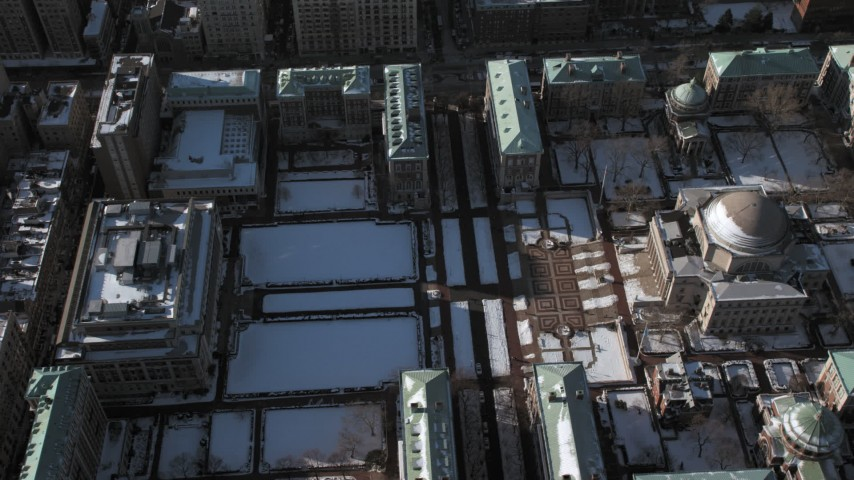 Columbia University with snow,  Morningside Heights New York City Aerial Stock Footage | AX66_0079