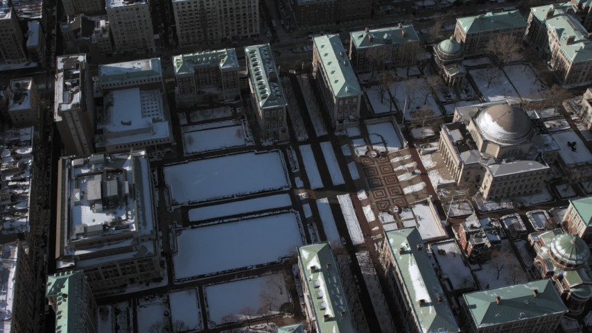 5K stock footage aerial video of Columbia University campus with snow in Morningside Heights, New York City Aerial Stock Footage | AX66_0079