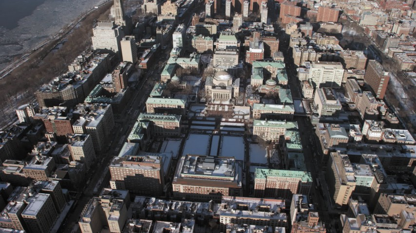 5K stock footage aerial video of circling around the Columbia University campus with snow, Morningside Heights, New York City Aerial Stock Footage | AX66_0080