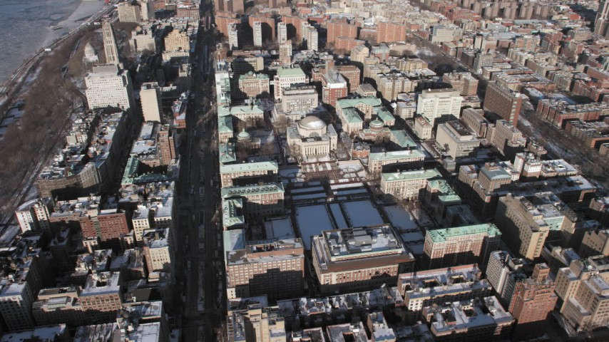 5K stock footage aerial video circle around the campus of Columbia University with snow, Morningside Heights, New York City Aerial Stock Footage | AX66_0081
