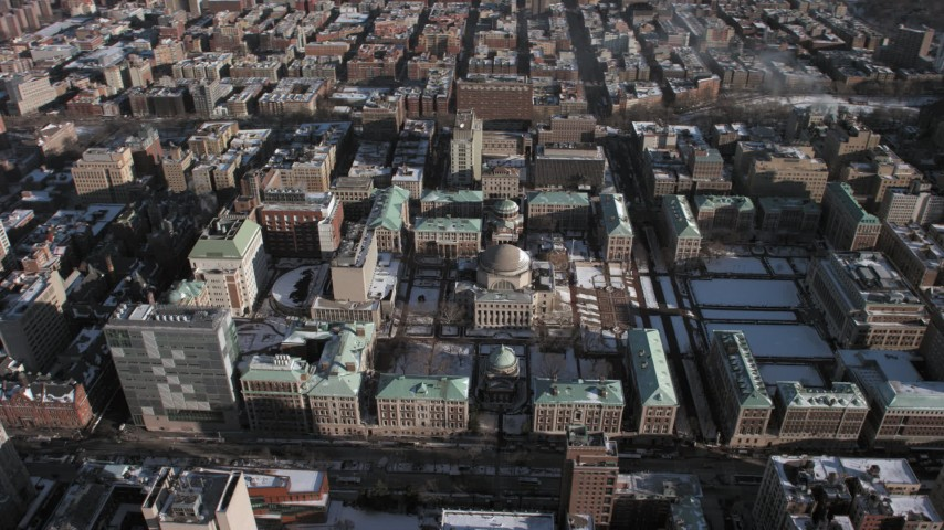 5K stock footage aerial video of orbiting the snowy campus of Columbia University, Morningside Heights, New York City Aerial Stock Footage | AX66_0082