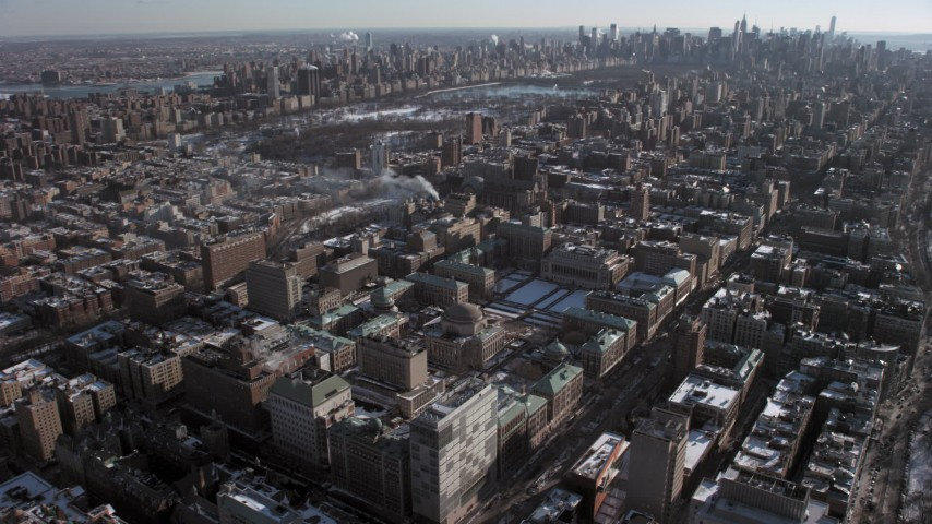 5K stock footage aerial video tilt from Columbia University to reveal Central Park and Midtown, New York City Aerial Stock Footage | AX66_0083
