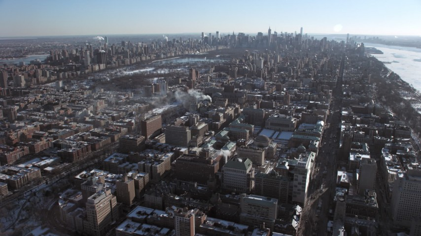 5K stock footage aerial video of Columbia University with Central Park and Midtown in the background, New York City Aerial Stock Footage | AX66_0084