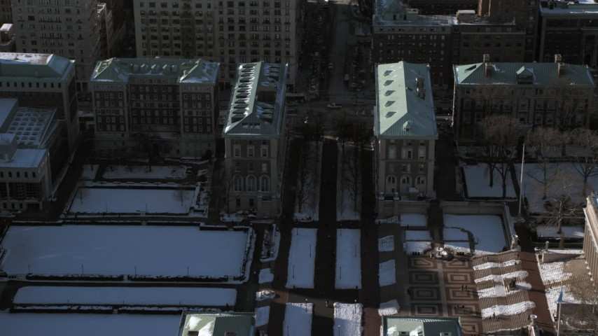 5K stock footage aerial video fly over snowy Columbia University to approach the Graduate School of Journalism, New York City Aerial Stock Footage | AX66_0092