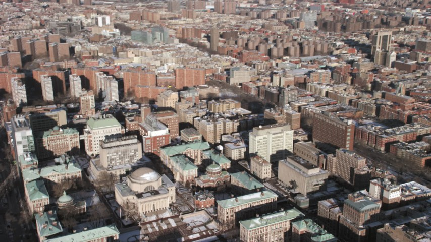 5K aerial video tilt from Harlem to reveal Columbia University with snow, New York City Aerial Stock Footage | AX66_0093