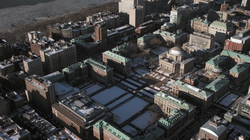 5K stock footage aerial video of Columbia University campus with snow, New York City Aerial Stock Footage | AX66_0094